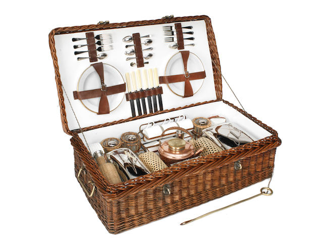 An impressive wicker-cased picnic set for six persons by G W Scott & Sons, circa 1909,