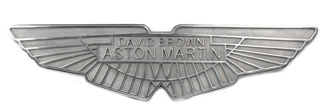 A cast aluminium sign depicting the David Brown Aston Martin winged logo,