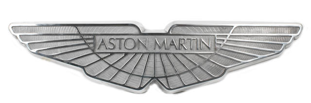 A cast aluminium sign depicting the Aston Martin winged logo,