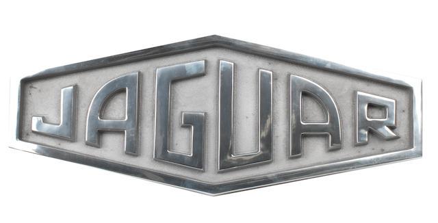 A cast aluminium sign depicting the 1961-1963 Jaguar logo,