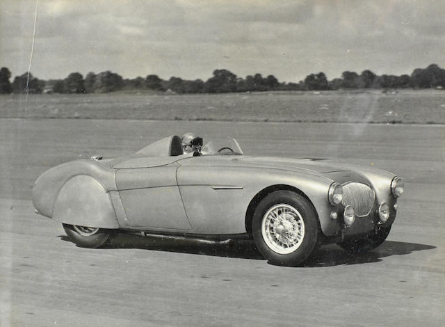 Donald Healey's personal photograph showing him test driving the 1953 modified Austin Healey '100' car at Gaydon Airfield and four AAA certificates,