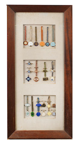 A framed display of 26 mainly Brooklands Aero Club and BARC members' and guests' enamel lapel badges, 1920s-1960s,