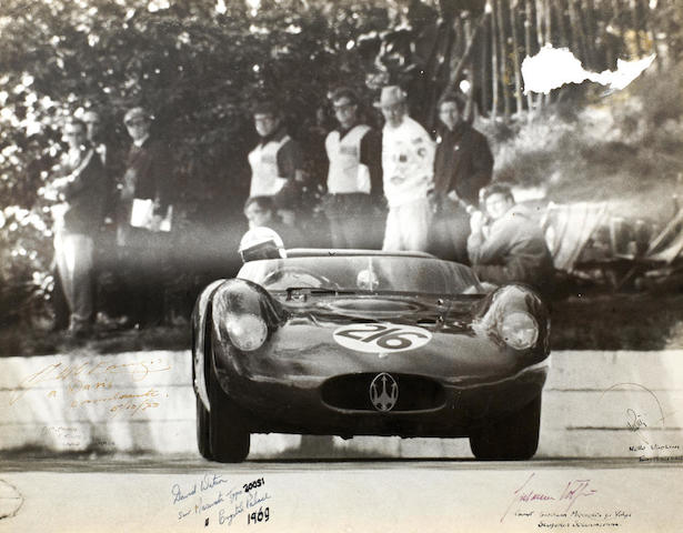 A large photograph depicting David Watson in Jo Bonnier's Maserati tipo 200si at Crystal Palace 1969, signed by Fangio and others,