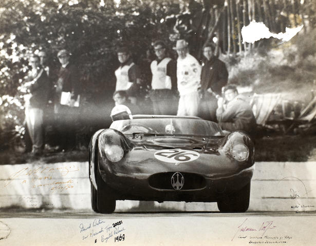 A large photograph depicting David Watson in Jo Bonnier's Maserati tipo 200si at Crystal Palace 1969, signed by Fangio and others,   ((4))