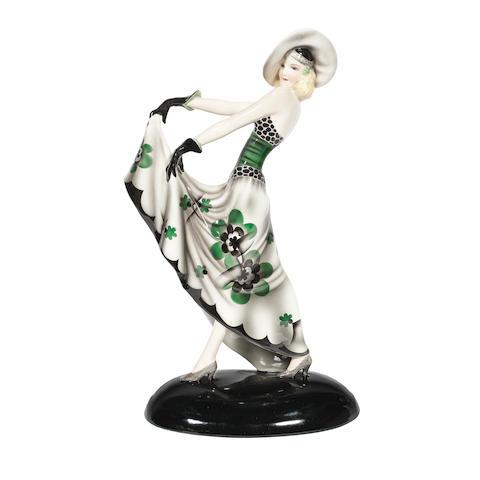 A Goldscheider art deco ceramic model of a stylish lady in floral dress by dakon MAKER'S MARKS, CIRCA 1925