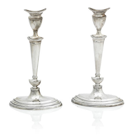 A pair of early 20th century silver candlesticks by Goldsmiths & Silversmiths Company, London 1905