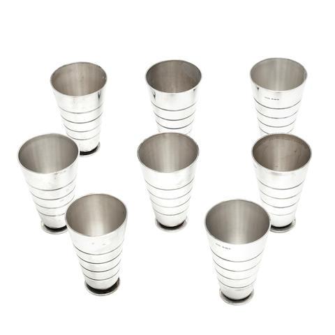 A Set of Eight Danish Silver Beakers, designed by Sigvard Bernadotte (1907-2002) MARK OF GEORG JENSEN, COPENHAGEN, 1925-1932