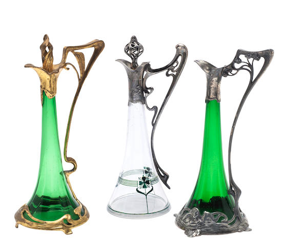 a wmf figural pewter art nouveau decanter with green glass liner STAMPED MAKER'S MARKS, CIRCA 1900
