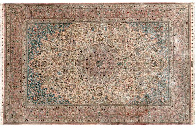 A central Persian silk rug 254 x 152cm