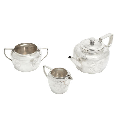 a Hukin & Heath Chased Plated Metal Three-piece teaset designed by christopher dresser STAMPED MAKER'S AND DESIGNER NAMES, DATE CODE FOR 1876