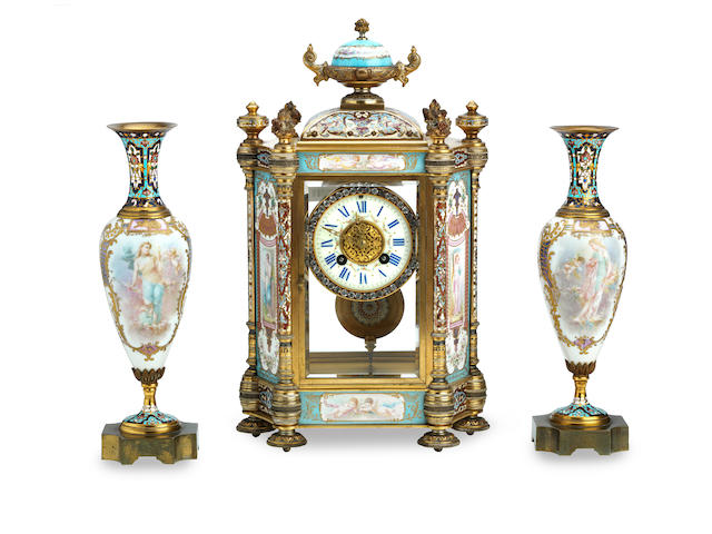 A late century French champleve enamel and porcelain mounted  clock garniture The movmement stamped Maple & Co ltd Paris 3