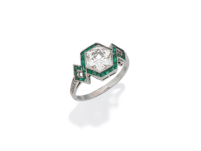 An emerald and diamond ring,