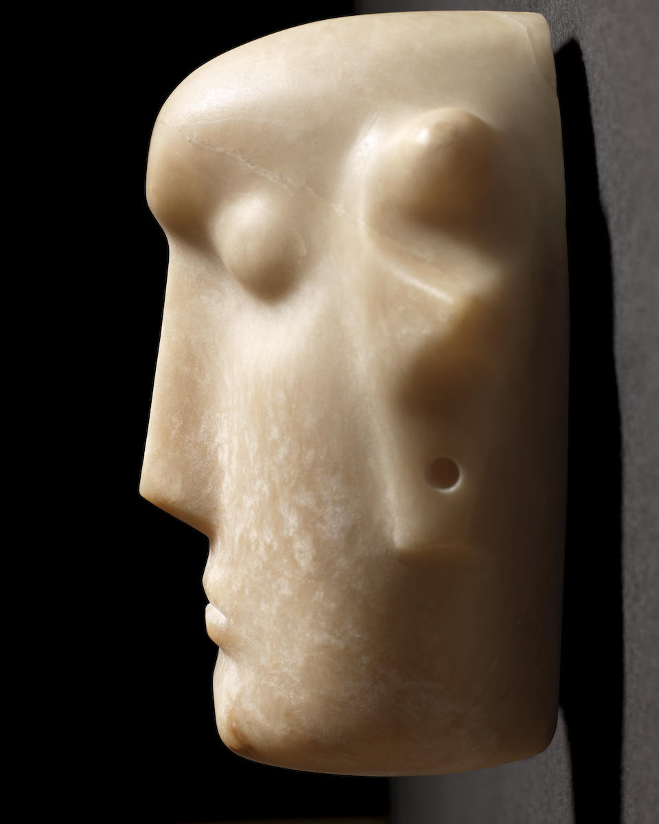 Henry Moore O.M., C.H. (British, 1898-1986) Mask 19.2 cm. (7 1/2 in.) high (Carved in 1929)