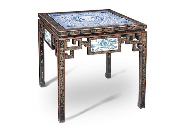 A porcelain-inset lacquered hardwood table 19th century