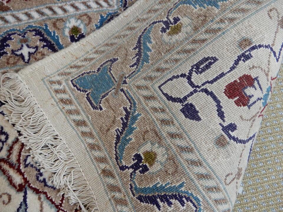 A central persian carpet 240cms x 350cms