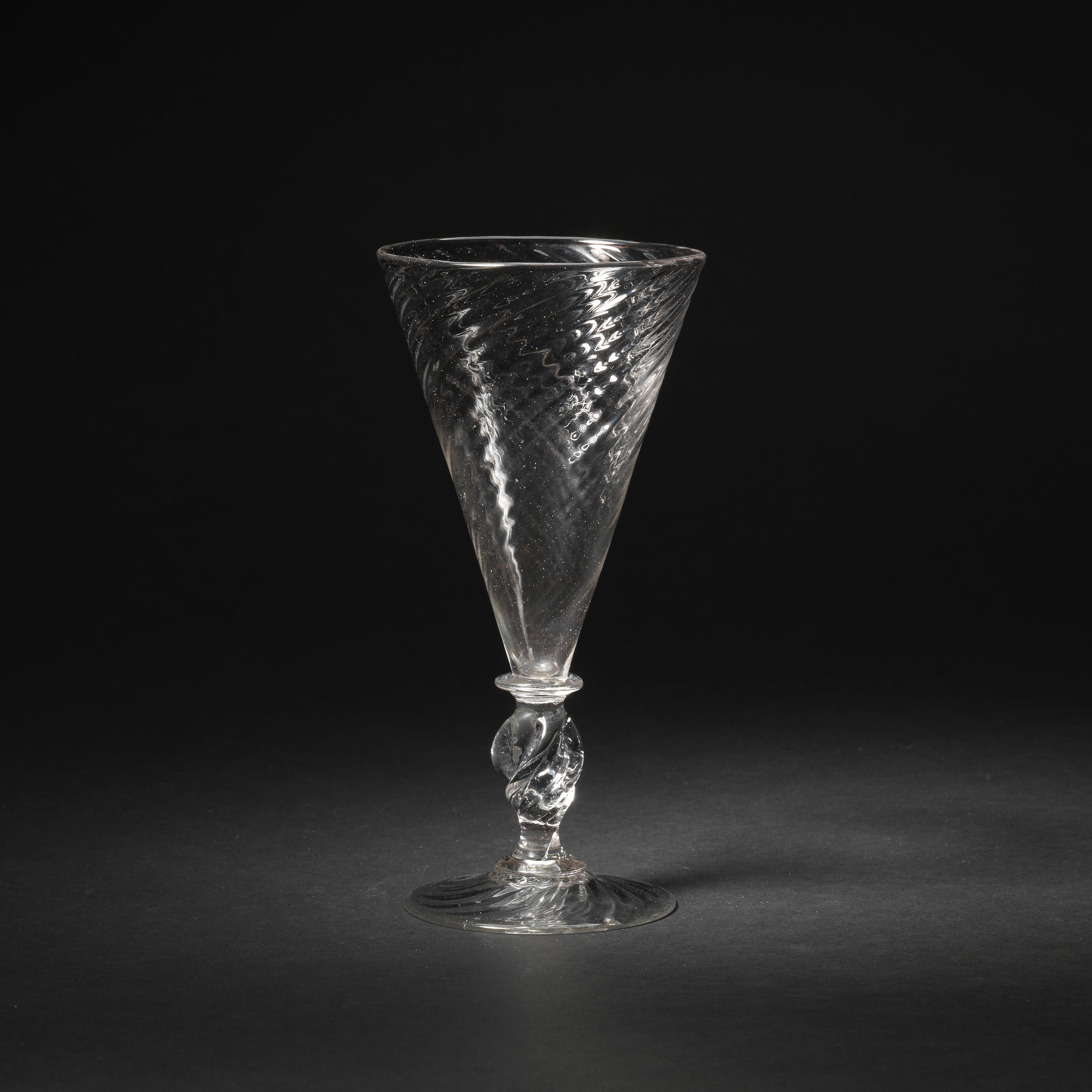 A wine or ale glass with a propeller stem, end 17th century