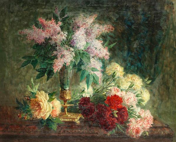 Pierre Eugène Montezin (French, 1874-1946) An arrangement of lilacs, roses and carnations