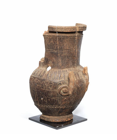 A fragmentary Egyptian wood vase