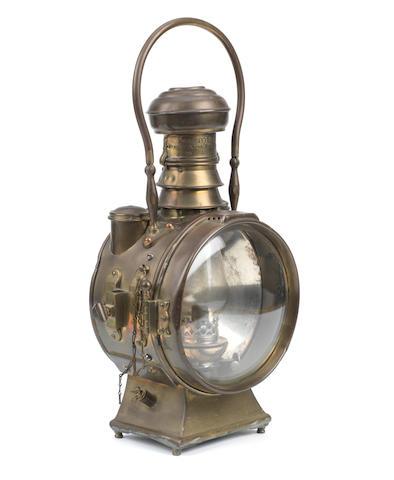"A ""The Polkey"" oil-illuminating headlamp,"