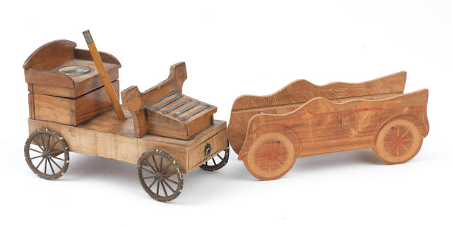A wooden motorcar deskpiece a souvenir of the Lakes at Retournemer and Longemer, French, circa 1905,   ((2))