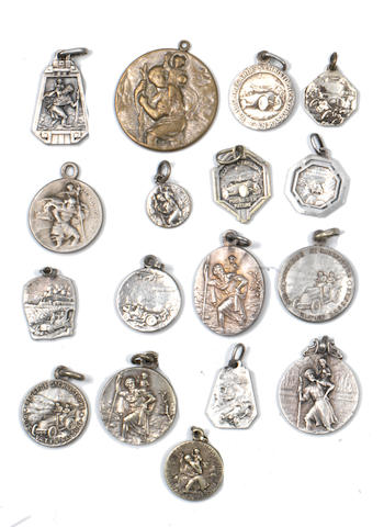 A collection of seventeen St. Christopher motoring fobs, majority pre-1918,  ((17))
