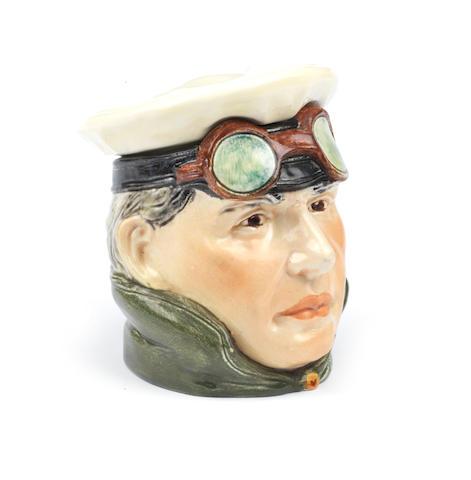 A 'Motorist' ceramic tobacco humidor, by Wilhelm Schiller & Son, German,