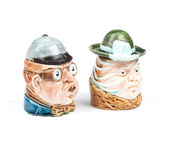 A pair of Peko-style 'Lady and Gentleman Motorist' ceramic tobacco humidors, German,   ((2))