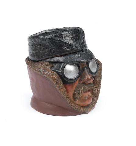 A 'Veteran Motorist' ceramic tobacco humidor, German,