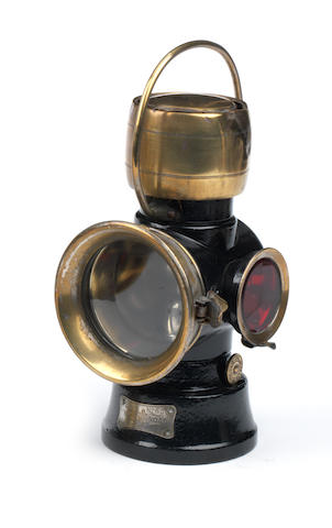 A Lucas 'King of the Road' No.630 oil-illuminating number-plate lamp,