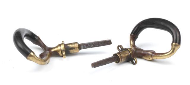 A pair of brass loop carriage handles,   ((2))