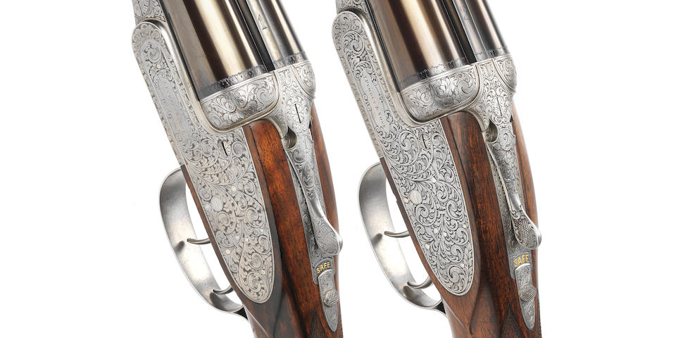 A fine matched pair of 12-bore self-opening sidelock ejector guns by James Purdey & Sons, no. 18259 & 18259* In their leather motor case (handle broken, straps missing)