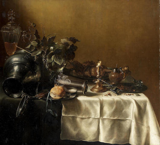 Attributed to Pieter Claesz. (Burgsteinfurt 1597-1660 Haarlem) An upturned pewter jug, silver beaker, a candlestick with a pewter platter, a glass cup and cover, mustard pot and a vine on a draped table
