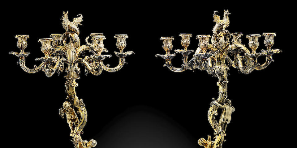 An important pair of William IV silver-gilt six-light candelabra from the Pembroke Service by Paul Storr, London 1835, each engraved 'Published as the Act directs by Storr and Mortimer 156 New Bond Street, London Octr 15, 1835. Nr 42'