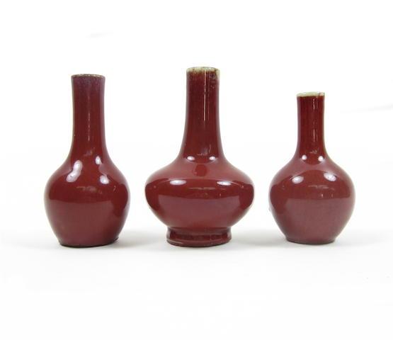 Two sang-de-boeuf vases together with a flambé-glazed vase (3)