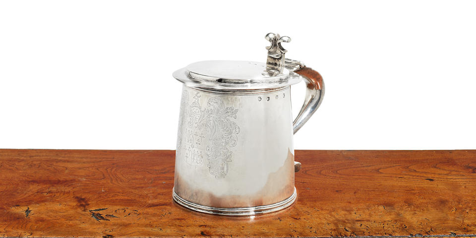 A rare Charles II provincial silver tankard by John Wilkinson I, Newcastle, circa 1660, struck with maker's mark IW, and pre-assay office marks, turret and twice with a lion passant to the cover and body
