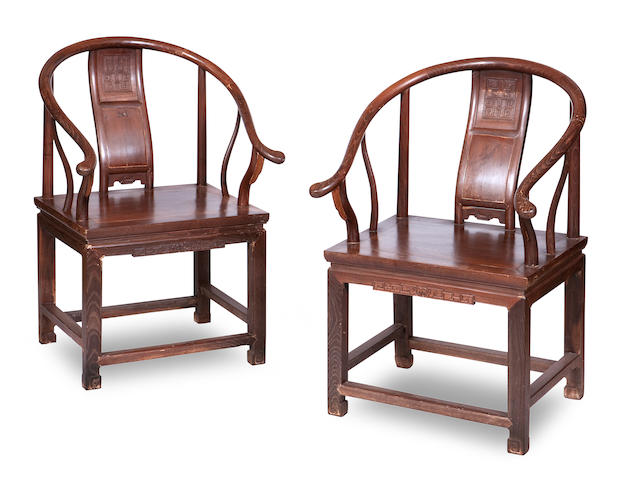 A pair of hardwood horseshoe back armchairs, quanyi 20th century (2)