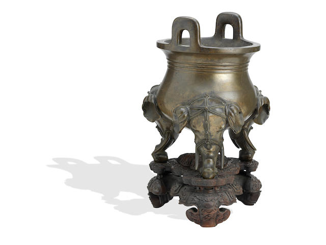 A large and impressive bronze tripod incense burner on wood stand Well defined Xuande six-character mark but 19th century (2)