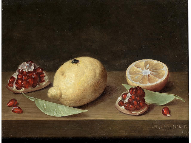 Jacob van Hulsdonck (Antwerp 1582-1647) A whole lemon, a sliced lemon and pomegranate on a table-top