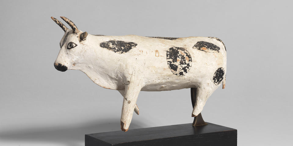 An Egyptian painted wood model of a bull