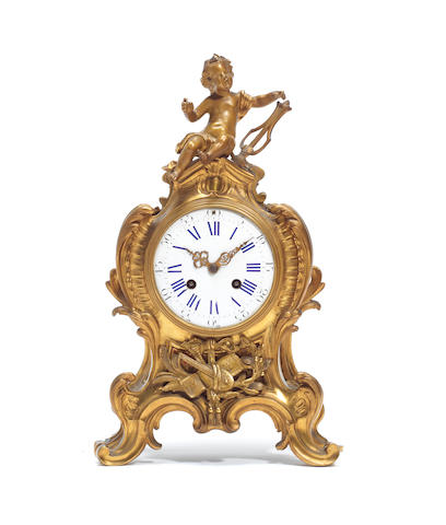 A third quarter 19th century French gilt bronze figural mantel clock in the Louis XV style, the movement stamped GV for Gay Vicarino & Co, Paris
