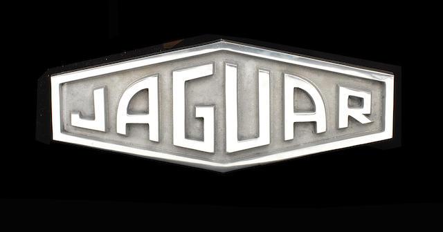 A CAST ALUMINIUM SIGN DEPICTING THE 1961-1963 JAGUAR EMBLEM,