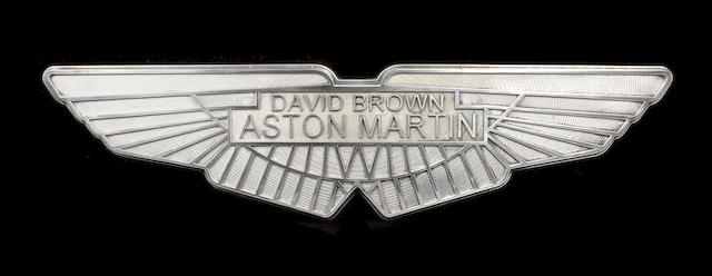 A CAST ALUMINIUM SIGN DEPICTING THE DAVID BROWN ASTON MARTIN WINGED EMBLEM,