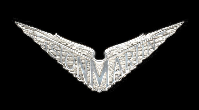 A CAST ALUMINIUM SIGN DEPICTING THE PRE-WAR ASTON MARTIN WINGED EMBLEM,