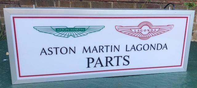 "AN ""ASTON MARTIN LAGONDA PARTS"" ILLUMINATED HANGING SIGN,"