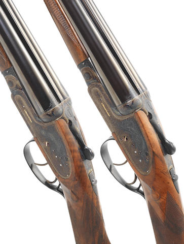 A fine pair of 20-bore sidelock ejector guns by C. Hellis & Sons, no. 6064/5 In their brass-mounted oak and leather case with accessories