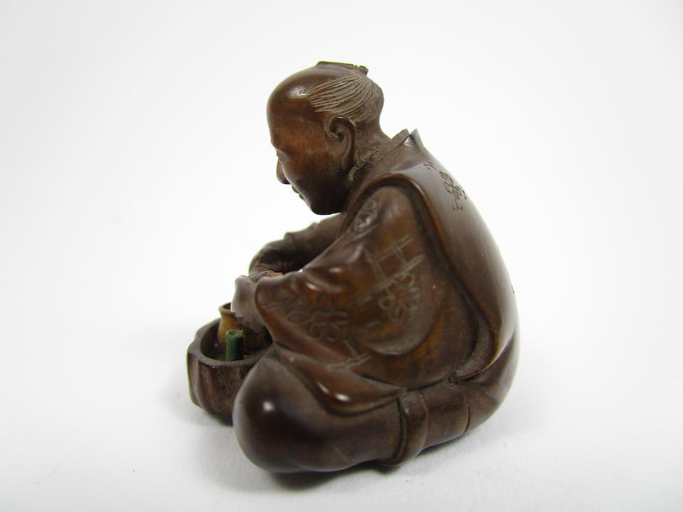 A carved wood netsuke By Sokoku, born 1920