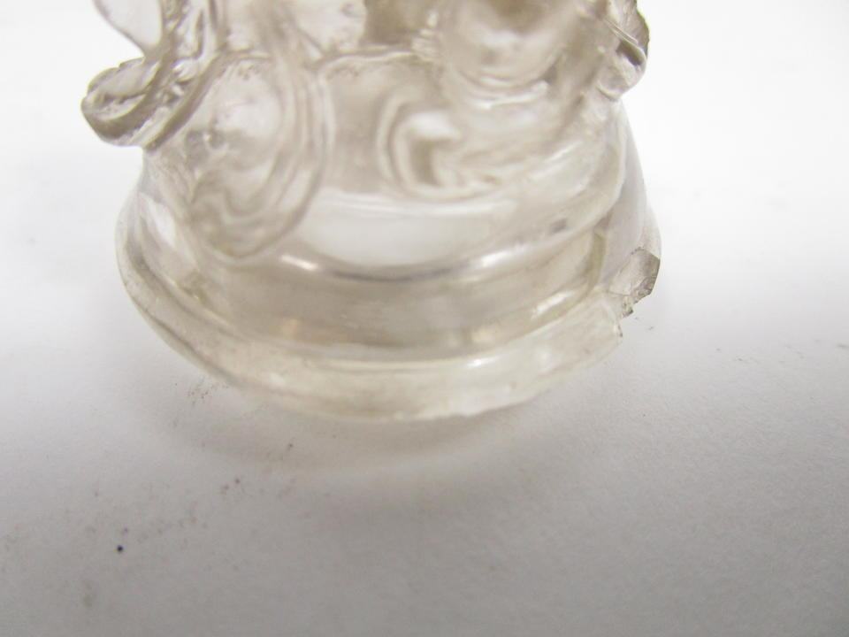 A rock crystal jarlet and cover and a soapstone snuff bottle and cover 19th century (4)