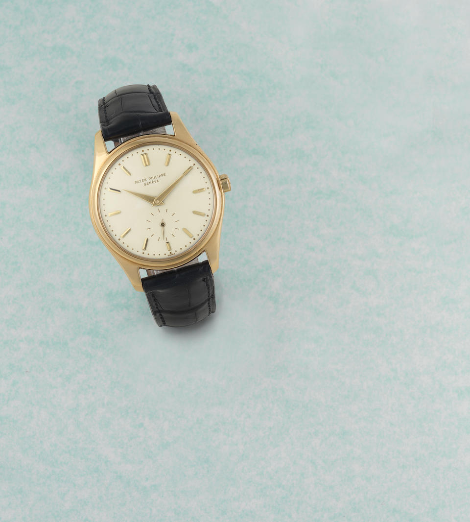 Patek Philippe. A fine and rare 18K gold automatic wristwatch with enamel dial  Calatrava, Ref: 2526, Sold April 14th 1958