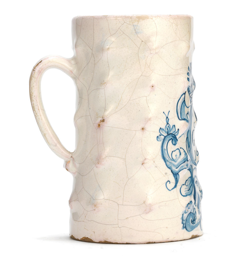 An exceptional London delftware 'bossed' tankard, dated 1653