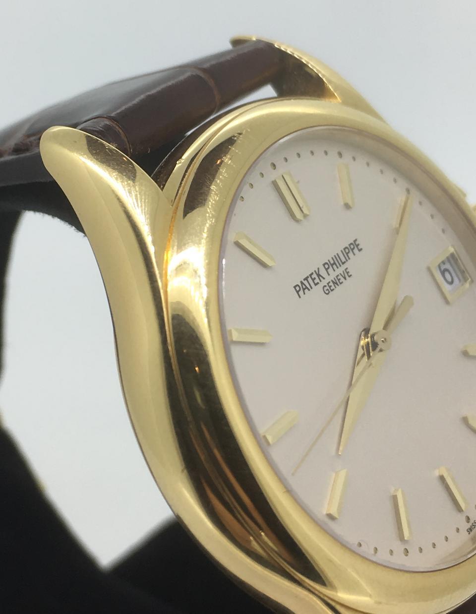 Bonhams Patek Philippe An 18k Gold Automatic Calendar Wristwatch